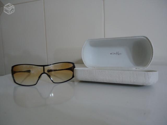 f076471c8 ... Sol Oakley Feminino - Dangerous. Óculos Oakley Dart