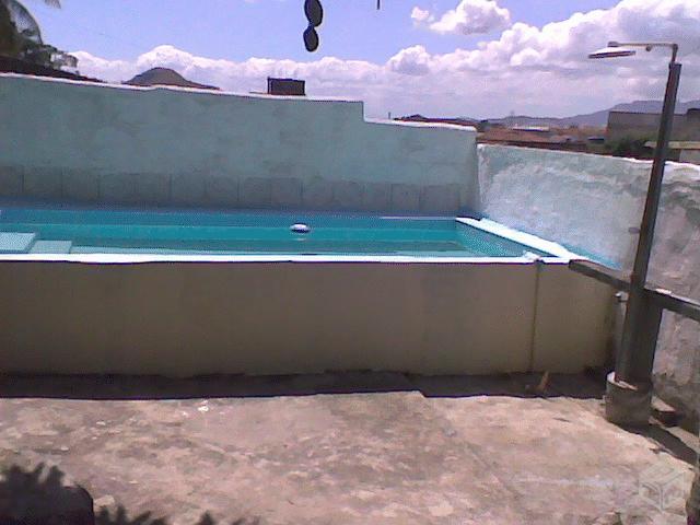 Casa com metros construidos piscina aquecida ofertas for Piscina inflavel 8 mil litros