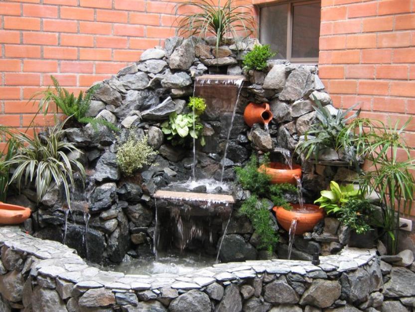 construir gruta jardim:Cascatas, fontes e jardins em pedra natural. Diferentes