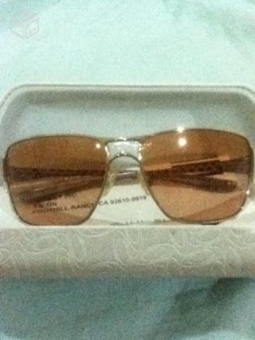 oculos oakley remedy dourado   OFERTAS     Vazlon Brasil d4f45dd616