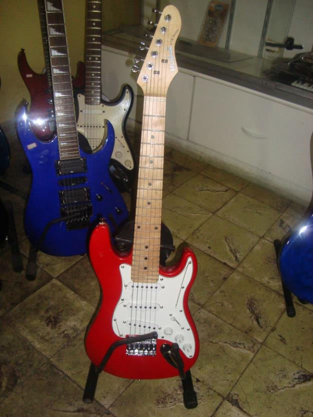 Guitarra Michael Strato infantil na Brother