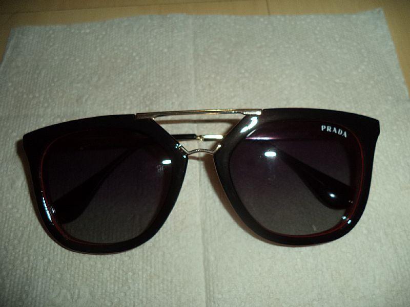 61acdd93a Óculos Prada novo redondo onça - Loja de carollesbolsas oculos de sol da  griffe marie claire preto [ OFERTAS .