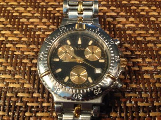 643dd9348b0 relogio masculino bulova analogico wb31989u dourado com fundo preto ...